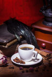 Cup of coffee, dry rose and grinder Stock Image