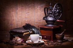 Cup of coffee, dry rose and grinder Stock Images
