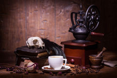 Cup of coffee, dry rose and grinder Royalty Free Stock Photo