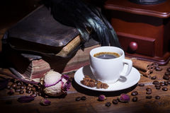 Cup of coffee, dry rose and grinder Royalty Free Stock Images