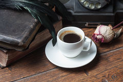 Cup of coffee, dry rose and old telephone Royalty Free Stock Photography