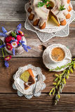 Cup of coffee, easter cake and spring flowers Stock Images