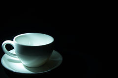 Cup of coffee. Empty coffee cup on a black background Stock Photo