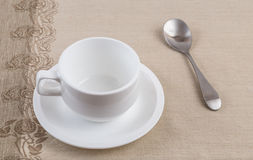 A cup of coffee. An empty cup of coffee and spoon Stock Image