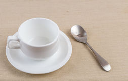 A cup of coffee. An empty cup of coffee with stainless spoon Stock Photography