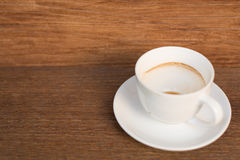 A cup of coffee is empty on the table. Stock Image