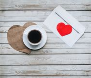 A cup of coffee and an envelope with a letter of love. Copy space. Royalty Free Stock Photos
