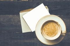 A cup of coffee and an envelope with a letter stock photography