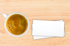 Cup of coffee and envelops on wooden table Stock Images