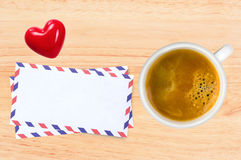 Cup of coffee and envelops on wooden table Stock Photo