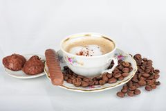 Cup of coffee. Cup of espresso with coffee beans and sweets on white background Royalty Free Stock Photos
