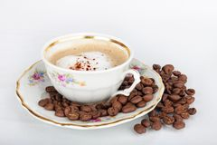 Cup of coffee. Cup of espresso with coffee beans on white background Royalty Free Stock Images