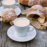 Cup of coffee espresso. A cup of coffee espresso and croissant on the wooden table Stock Photography