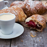 Cup of coffee espresso and croissant. A cup of coffee espresso and croissant on the wooden table. Tonned photo Royalty Free Stock Image