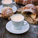 Cup of coffee espresso and croissant. A cup of coffee espresso and croissant on the wooden table. Tonned photo Stock Photography