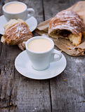 Cup of coffee espresso and croissant. A cup of coffee espresso and croissant on the wooden table. Tonned photo Royalty Free Stock Images
