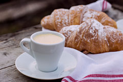 A cup of coffee espresso and croissant Stock Image