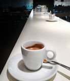 Cup of coffee espresso. Cup of coffee espresso on a large white table, perspective view Stock Photos