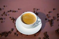 Cup of coffee, cup of espresso, latte macchiato, brown backgroun Stock Photo
