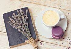A cup of coffee espresso. Macaroon notebook and a bouquet of lavende Stock Images