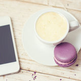 A cup of coffee espresso. Macaroon and a telephone Royalty Free Stock Images