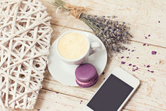 A cup of coffee espresso. Macaroon and a telephone Stock Photography