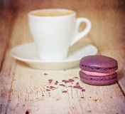 A cup of coffee espresso and  macaroon. Toned photo Royalty Free Stock Photo