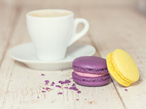 A cup of coffee espresso and macaroon. Toned photo Stock Photo
