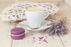 A cup of coffee espresso. And  macaroon. toned photo Royalty Free Stock Photo