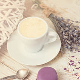 A cup of coffee espresso. And  macaroon. toned photo Royalty Free Stock Images