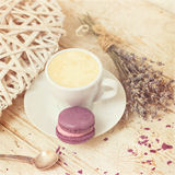 A cup of coffee espresso and macaroon. Toned photo Royalty Free Stock Photography