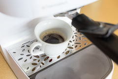 Cup of coffee from espresso machine Stock Image