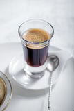 Cup of coffee. Espresso with a spoon Royalty Free Stock Image