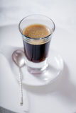 Cup of coffee. Espresso with a spoon Stock Photos