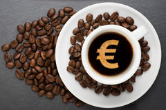 Cup of coffee with euro Royalty Free Stock Images