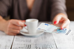 Cup of coffee and 20 euro note Stock Image