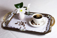 Cup of coffee on exquisite embroidered napkin. On silver serving tray. Best hotel service concept Stock Photos