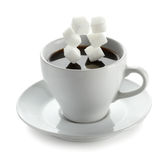 Cup of coffee with falling sugar cube Royalty Free Stock Images