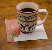 Cup of coffee on festive napkin Royalty Free Stock Images