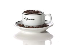 Cup of coffee. A coffee cup filled with beans Royalty Free Stock Images