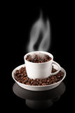 Cup of coffee filled with grains with smoke Stock Photos