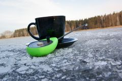 Cup of coffee and fishing rod Stock Image