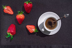 Cup of coffee and five strawberries. On dark chocolate background royalty free illustration