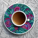 Cup of coffee and floral ornament Stock Photos