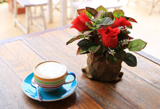 A cup of coffee with flower Royalty Free Stock Image