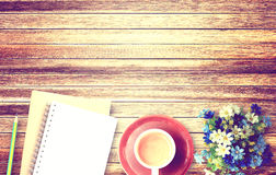 Cup of coffee and flower on wooden table background Royalty Free Stock Photos