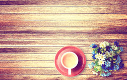 Cup of coffee and flower on wooden table background Royalty Free Stock Images