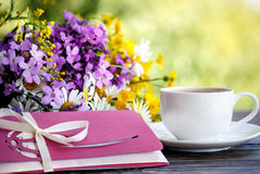 Cup of coffee,  flowers and an envelope Royalty Free Stock Image