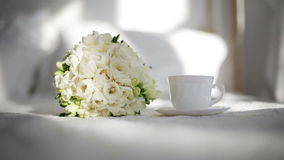 Cup of coffee and flowers in the morning in the bedroom.  stock video