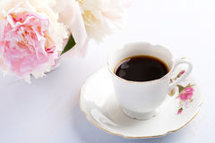 Cup of coffee and flowers. Stock Photos